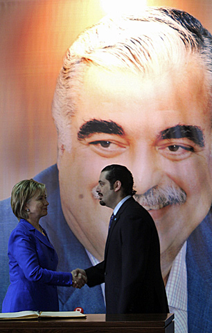 U.S. Secretary of State Hillary Clinton meets with Lebanese Prime Minister Saad Hariri (the son of Rafik) in April 2009, in advance of a critical election. Saad Hariri has retracted some of his earlier comments about Syrian involvement in his father's death but the West is still applying pressure. (Bilal Hussein/Associated Press)