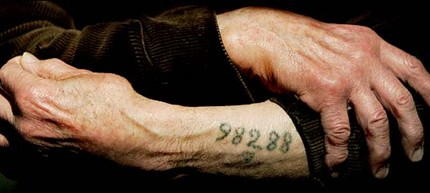 Auschwitz survivor Leon Greenman displays his number tattoo. (photo: Ian Waldie/Getty Images)