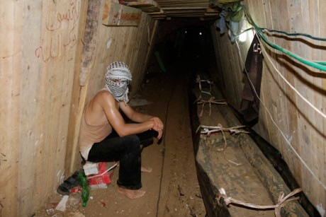 A Palestinian sits in a smuggling tunnel beneath the Egyptian-Gaza border in Rafah.