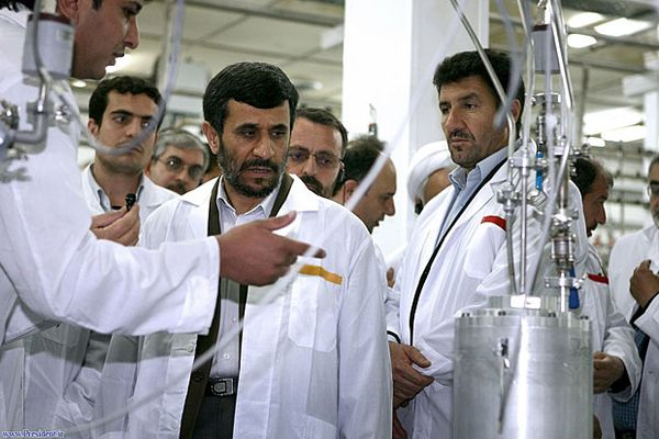 Photo: Iranian President Mahmoud Ahmadinejad, center, listens to a technician during his visit of the Natanz Uranium Enrichment Facility some 200 miles south of Tehran on April 8, 2008. Credit: Iranian's President's office / Associated Press
