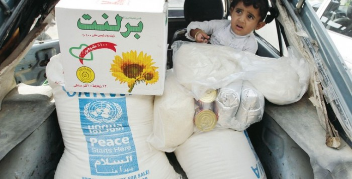 A palestinian boy sits in a car after his family received food supplies from the UNRWA headquarters in Rafah in the southern Gaza Strip, in this photo from November, 2012.. (photo credit:REUTERS)