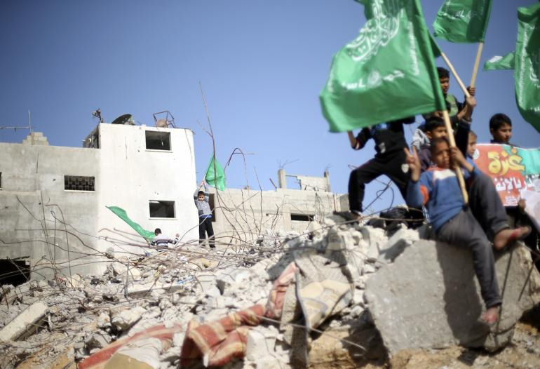 Hamas' new social media campaign hit a stumbling block when its #AskHamas hashtag on Twitter was appropriated by critics, who used it to mock the Palestinian group. Palestinian boys are pictured here holding Hamas flags in Beit Hanoun in the northern Gaza Strip, Jan. 30, 2015. Reuters/Mohammed Salem