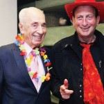 TWO-GUN HULDAI (right) and a 'lei-d back' Shimon Peres at the Purim party they co-hosted. . (photo credit:SALI BEN-ARIEH)