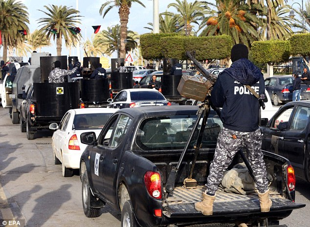Military intervention: As Libyan soldiers protected the capital Tripoli (pictured on February 9), the elected parliament was forced to relocate in the eastern city of Tobruk