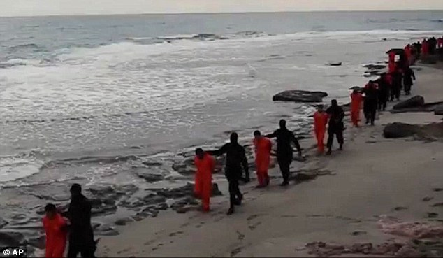 Executed:At least 35 more Egyptians are believed to have been kidnapped by jihadists in Libya, raises the chilling prospect of yet another mass execution like the one seen on Sunday when the Islamic State released a horrific videoshowing the beheading of 21 Christians on a beach (above)