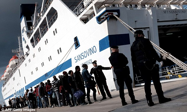 Escape: Today, the spread of violence and extremism in Libya has forced thousands to flee to Italy (ferry port of Lampedusa pictured) where officials are struggling to deal with the sudden influx