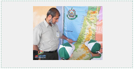 """""""Educating"""" the younger generation with maps: A counsellor in a Hamas summer camp in the Gaza Strip points to a map of """"Palestine"""" issued by Hamas which ignores the existence of the State of Israel (Filastin al-A'an, June 8, 2016). Important Israeli cities do not appear on the map. Jaffa, considered a """"Palestinian city,"""" replaces Tel Aviv, and Um-Khaled, an Arab village which no longer exists, replaces Netanya."""