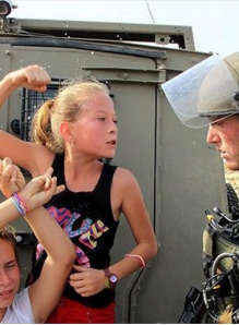 Ahed Tamimi threatens an IDF soldier (al-Anadolu News, December 30, 2012).