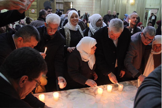 Participants at the event light 36 candles, one for each year of imprisonment.